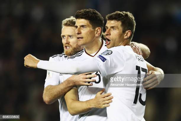 Mario Gomez celebrates scoring the third goal with Andre Schuerrle Thomas Mueller of Germany during the FIFA 2018 World Cup Qualifiying group C match...