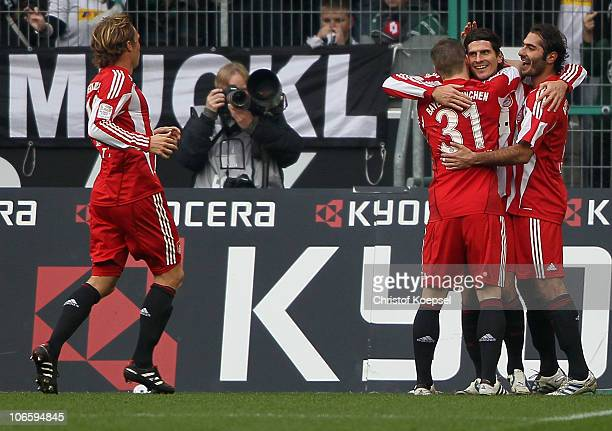 Mario Gomez celebrates the first goal with Hamit Altintop and Bastian Schweinsteiger during the Bundesliga match between Borussia Moenchengladbach...