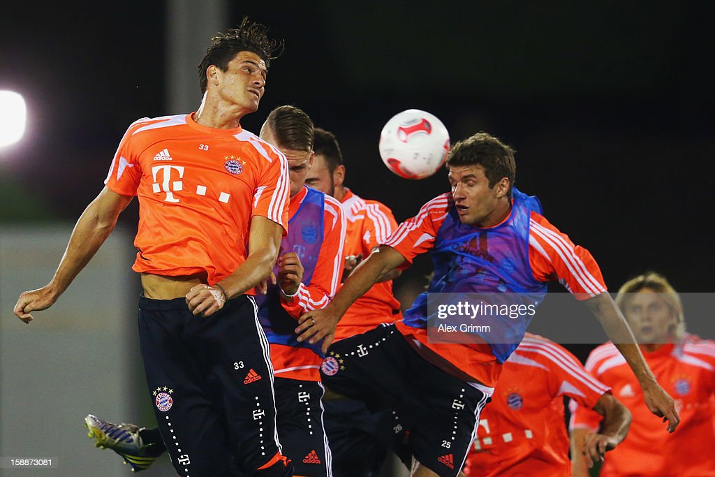 <a gi-track='captionPersonalityLinkClicked' href=/galleries/search?phrase=Mario+Gomez+-+Soccer+Player&family=editorial&specificpeople=635161 ng-click='$event.stopPropagation()'>Mario Gomez</a> (L) jumps for a header with <a gi-track='captionPersonalityLinkClicked' href=/galleries/search?phrase=Thomas+Mueller&family=editorial&specificpeople=5842906 ng-click='$event.stopPropagation()'>Thomas Mueller</a> during a Bayern Muenchen training session at the ASPIRE Academy for Sports Excellence on January 2, 2013 in Doha, Qatar.