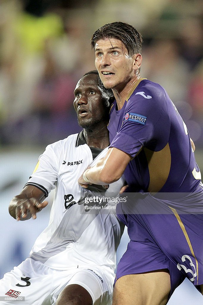 Mario Gomez of ACF Fiorentina reacts and Benjamin Angoua of EA Guingamp during the UEFA Europa League group K match between ACF Fiorentina and EA Guingamp at Stadio Artemio Franchi on September 18, 2014 in Florence, Italy.