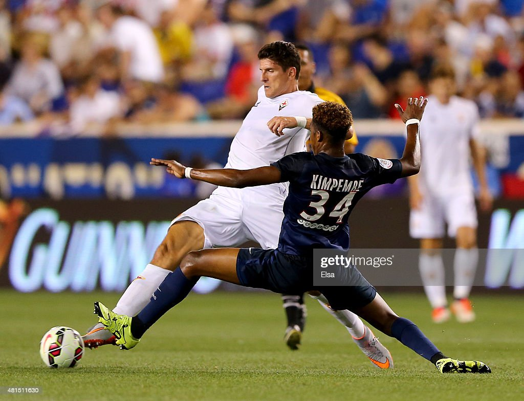 Mario Gomez #33 of AFC Fiorentina and Presnel Kimpembe #34 of Paris Saint-Germain fight for the ball in the first half during the International Champions Cup at Red Bull Arena on July 21, 2015 in Harrison, New Jersey.