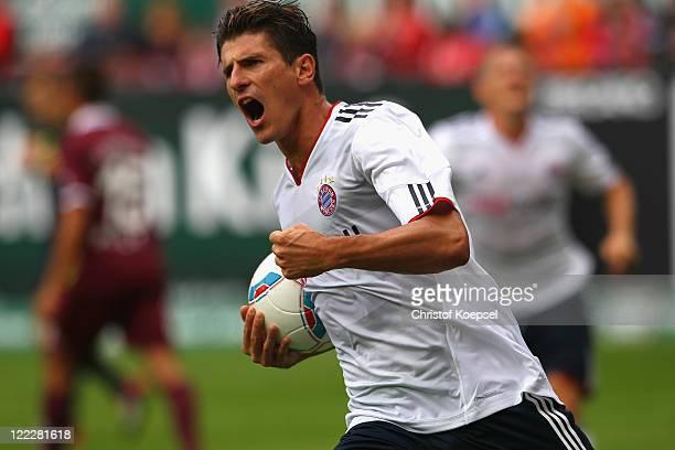 Mario Gomez of Bayern celebrates the first goal during the Bundesliga match between 1 FC Kaiserslautern and FC Bayern Muenchen at FritzWalterStadium...