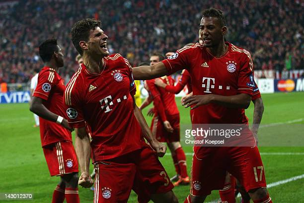 Mario Gomez of Bayern celebrates the second goal with Jérome Boateng during the UEFA Champions League Semi Final first leg match between FC Bayern...