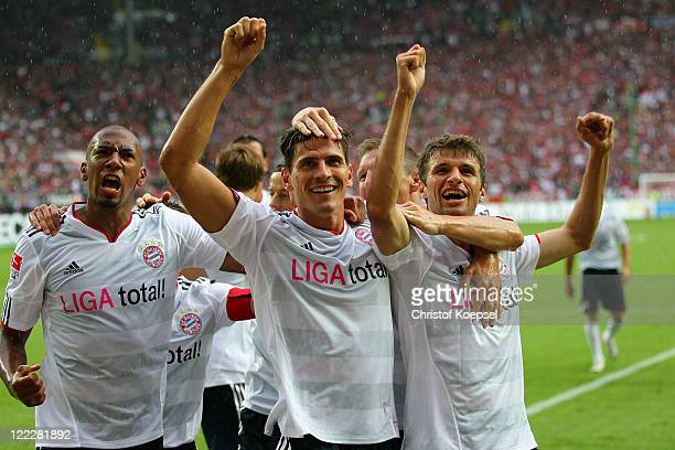 Mario Gomez of Bayern celebrates the third goal with Jérome Boateng and Thomas Mueller of Bayern during Bundesliga match between 1 FC Kaiserslautern...