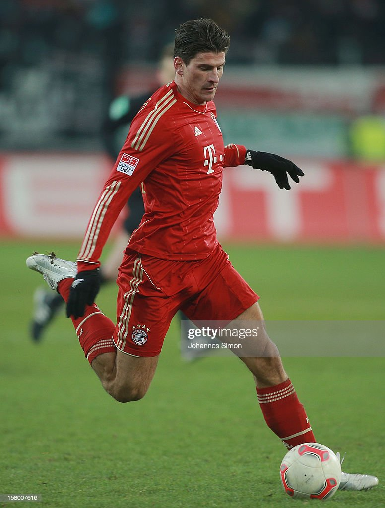 Mario Gomez of Bayern in action during the Bundesliga match between FC Augsburg and FC Bayern Muenchen at SGL Arena on December 8, 2012 in Augsburg, Germany.