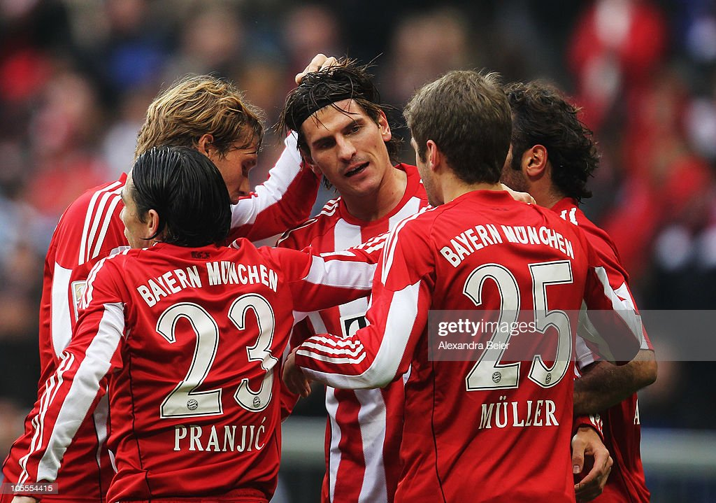 Mario Gomez (C) of Bayern Muenchen celebrates his first goal with <a gi-track='captionPersonalityLinkClicked' href=/galleries/search?phrase=Danijel+Pranjic&family=editorial&specificpeople=698546 ng-click='$event.stopPropagation()'>Danijel Pranjic</a>, <a gi-track='captionPersonalityLinkClicked' href=/galleries/search?phrase=Andreas+Ottl&family=editorial&specificpeople=645670 ng-click='$event.stopPropagation()'>Andreas Ottl</a>, <a gi-track='captionPersonalityLinkClicked' href=/galleries/search?phrase=Thomas+Mueller&family=editorial&specificpeople=5842906 ng-click='$event.stopPropagation()'>Thomas Mueller</a> and <a gi-track='captionPersonalityLinkClicked' href=/galleries/search?phrase=Hamit+Altintop&family=editorial&specificpeople=597992 ng-click='$event.stopPropagation()'>Hamit Altintop</a> (L-R) during their Bundesliga match between FC Bayern Muenchen and Hannover 96 at Allianz Arena on October 16, 2010 in Munich, Germany.