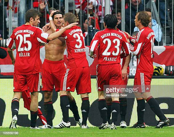 Mario Gomez of Bayern Muenchen celebrates his second goal with his teammates Thomas Mueller Bastian Schweinsteiger Danijel Pranjic and Andreas Ottl...