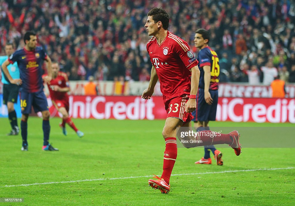 <a gi-track='captionPersonalityLinkClicked' href=/galleries/search?phrase=Mario+Gomez+-+Soccer+Player&family=editorial&specificpeople=635161 ng-click='$event.stopPropagation()'>Mario Gomez</a> of Bayern Muenchen celebrates scoring the second goal during the UEFA Champions League Semi Final First Leg match between FC Bayern Muenchen and Barcelona at Allianz Arena on April 23, 2013 in Munich, Germany.