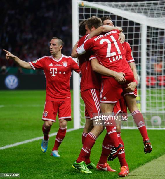 Mario Gomez of Bayern Muenchen celebrates with team mate Philipp Lahm and Franck Ribery as he scores their second goal during the DFB Cup Final match...