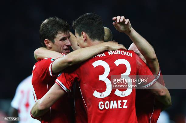 Mario Gomez of Bayern Muenchen celebrates with Thomas Mueller as he scores their third goal during the DFB Cup Final match between FC Bayern Muenchen...