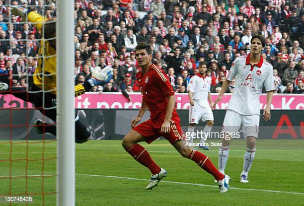 Mario Gomez of Bayern Muenchen scores a goal against goalkeeper Alexander Stephan of Nuernberg during the Bundesliga match between FC Bayern Muenchen...