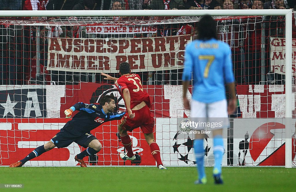 <a gi-track='captionPersonalityLinkClicked' href=/galleries/search?phrase=Mario+Gomez+-+Soccer+Player&family=editorial&specificpeople=635161 ng-click='$event.stopPropagation()'>Mario Gomez</a> (C) of Bayern Muenchen scores his second goal against Morgan de Sanctis goalkeeper of Napoli during the UEFA Champions League Group A match between FC Bayern Muenchen and SSC Napoli at Allianz Arena on November 2, 2011 in Munich, Germany.