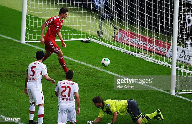 Mario Gomez of Bayern Muenchen scores their second goal during the DFB Cup Final match between FC Bayern Muenchen and VfB Stuttgart at Olympiastadion...