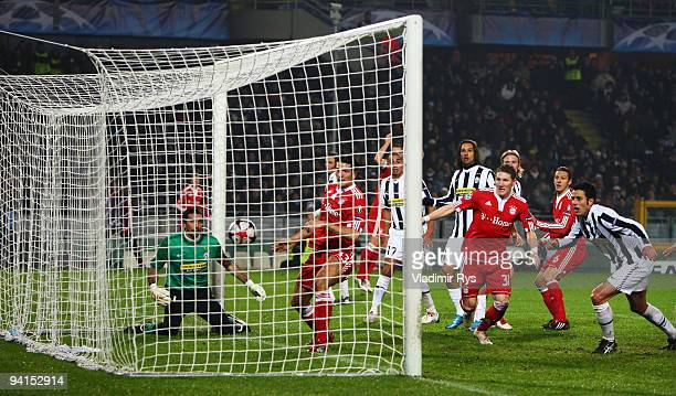 Mario Gomez of Bayern scores his teams third goal against Gianluigi Buffon of Juventus during the UEFA Champions League Group A match between...