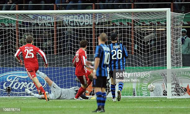 Mario Gomez of Bayern scores the opening goal during the UEFA Champions League round of 16 first leg match between Inter Milan v FC Bayern Muenchen...