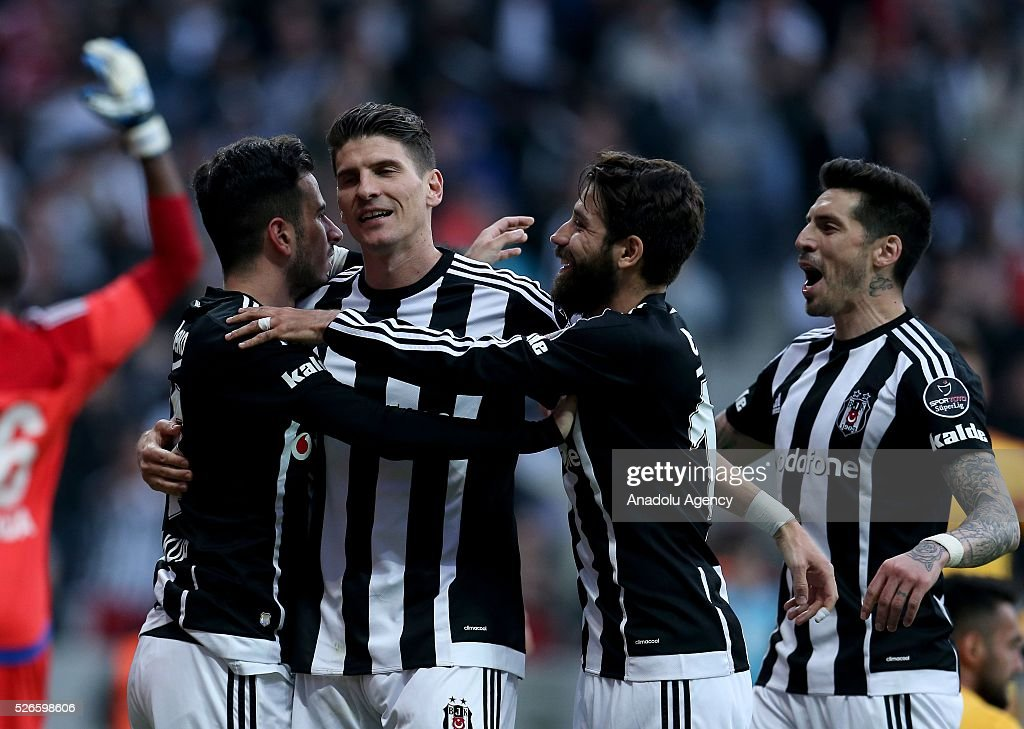 Mario Gomez (2nd L) of Besiktas celebrates with teammates after scoring a goal during the Turkish Super Toto Super Lig football match between Besiktas and Kayserispor at Vodafone Arena in Istanbul, Turkey on April 30, 2016.