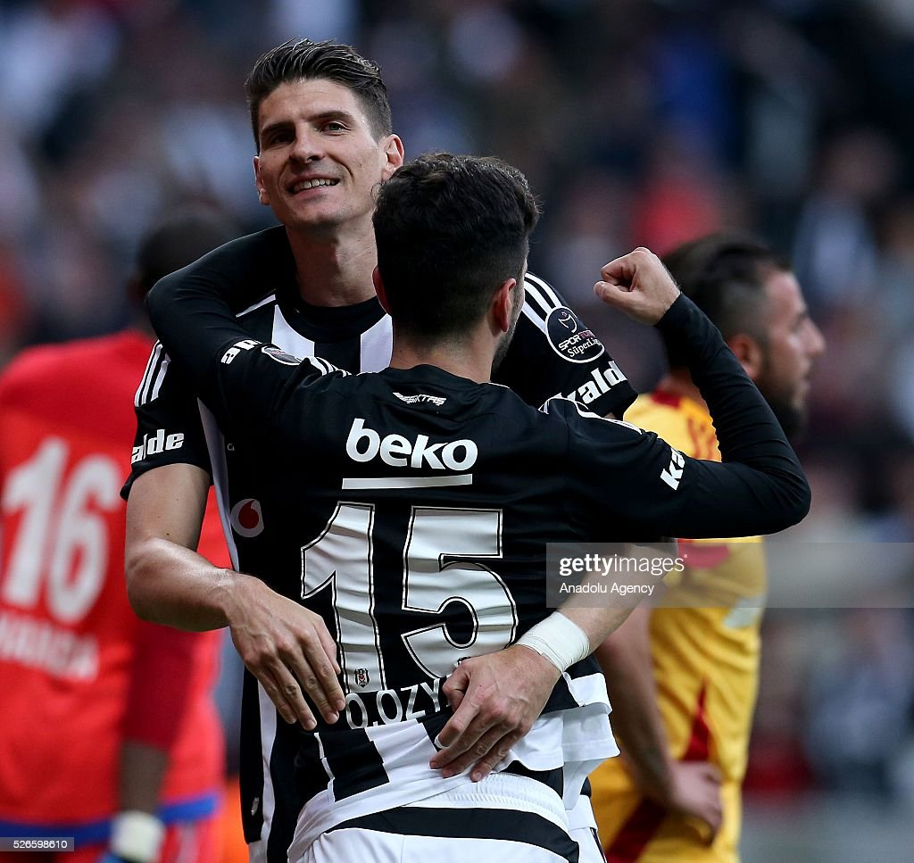 Mario Gomez (L) of Besiktas celebrates with teammates after scoring a goal during the Turkish Super Toto Super Lig football match between Besiktas and Kayserispor at Vodafone Arena in Istanbul, Turkey on April 30, 2016.