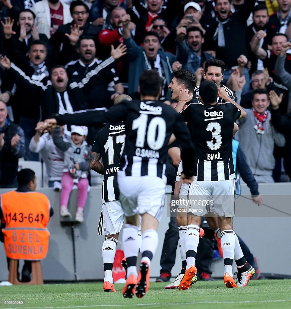 Mario Gomez of Besiktas celebrates with teammates after scoring a goal during the Turkish Super Toto Super Lig football match between Besiktas and Kayserispor at Vodafone Arena in Istanbul, Turkey on April 30, 2016.