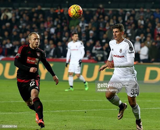 Mario Gomez of Besiktas in action against Alexander Larsson of Gaziantepspor during Super Toto Super League football match between Besiktas and...