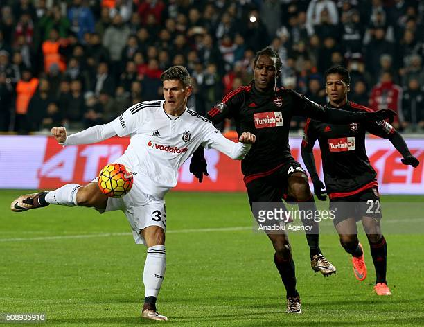 Mario Gomez of Besiktas in action against Mahamadou Bezannier and Lima Pacheco of Gaziantepspor during Super Toto Super League football match between...