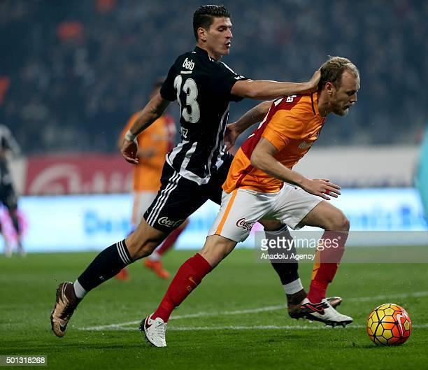 Mario Gomez of Besiktas in action against Semih Kaya of Galatasaray during the Turkish Spor Toto Super League football match between Besiktas and...