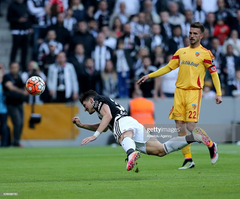Mario Gomez (L) of Besiktas scores a goal during the Turkish Super Toto Super Lig football match between Besiktas and Kayserispor at Vodafone Arena in Istanbul, Turkey on April 30, 2016.