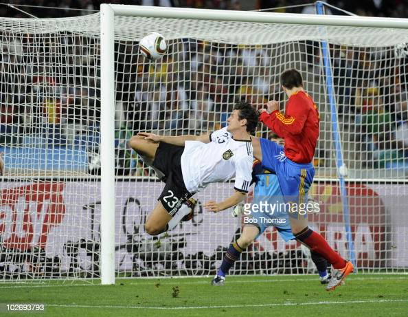 Mario Gomez of German in mid air during the 2010 FIFA World Cup South Africa Semi Final match between Germany and Spain at Durban Stadium on July 7...