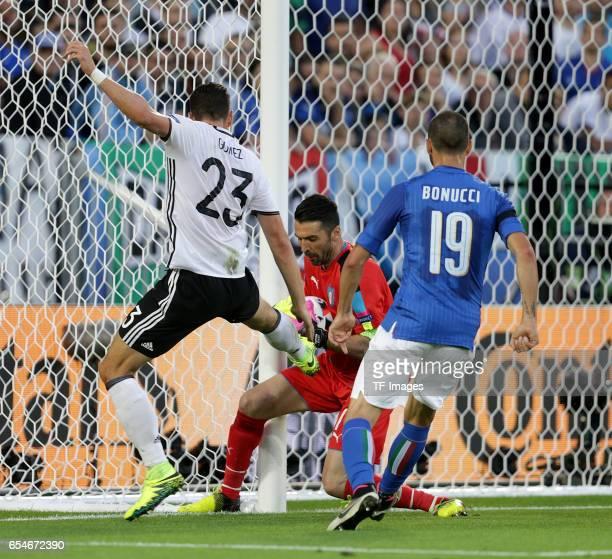 Mario Gomez of Germany and Goalkeeper Gianluigi Buffon of Italy and Leonardo Bonucci of Italy battle for the ball during the UEFA EURO 2016 quarter...