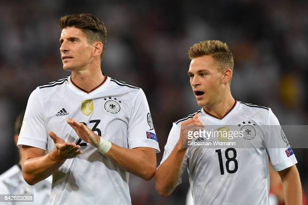 Mario Gomez of Germany and Joshua Kimmich of Germany celebrate after the FIFA 2018 World Cup Qualifier between Germany and Norway at MercedesBenz...