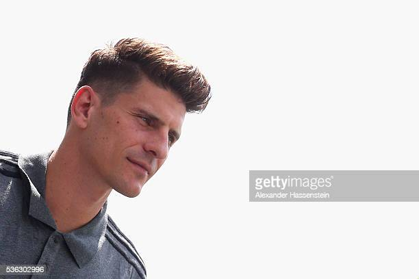 Mario Gomez of Germany arrives for a press conference on day 9 of the German national team trainings camp on June 1 2016 in Ascona Switzerland