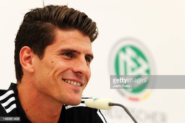 Mario Gomez of Germany attends a press conference ahead of their UEFA EURO 2012 Group B match against Denmark at the Germany press centre on June 15...