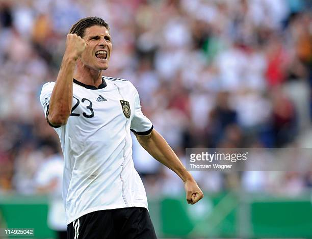 Mario Gomez of Germany celebrates after scoring his teams first goal during the international friendly charity match between Germany and Uruguay on...