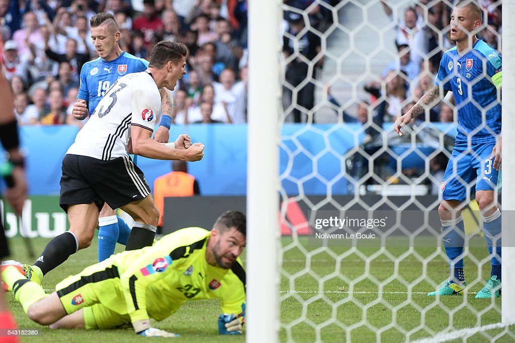 Mario Gomez of Germany celebrates his goal during the European Championship match Round of 16 between Germany and Slovakia at Stade Pierre-Mauroy on June 26, 2016 in Lille, France.