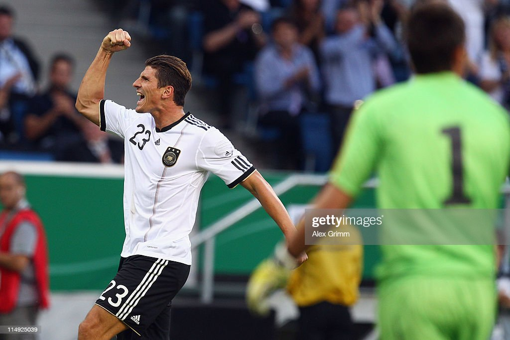 <a gi-track='captionPersonalityLinkClicked' href=/galleries/search?phrase=Mario+Gomez+-+Soccer+Player&family=editorial&specificpeople=635161 ng-click='$event.stopPropagation()'>Mario Gomez</a> of Germany celebrates his team's first goal as goalkeeper <a gi-track='captionPersonalityLinkClicked' href=/galleries/search?phrase=Fernando+Muslera&family=editorial&specificpeople=4283031 ng-click='$event.stopPropagation()'>Fernando Muslera</a> of Uruguay reacts during the international friendly charity match between Germany and Uruguay at Rhein-Neckar Arena on May 29, 2011 in Sinsheim, Germany.