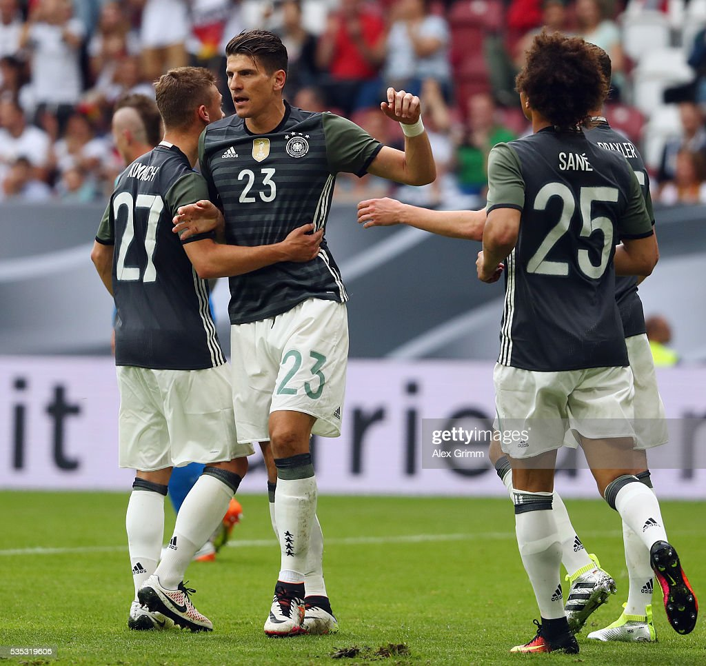 Mario Gomez of Germany celebrates his team's first goal with team mates during the international friendly match between Germany and Slovakia at WWK-Arena on May 29, 2016 in Augsburg, Germany.