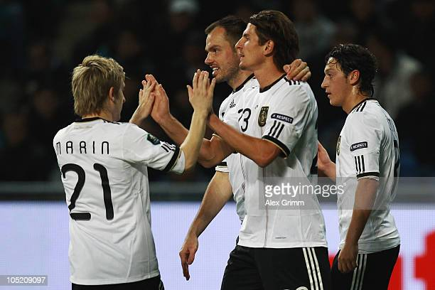 Mario Gomez of Germany celebrates his team's second goal with team mates Marko Marin Heiko Westermann and Mesut Oezil during the EURO 2012 group A...