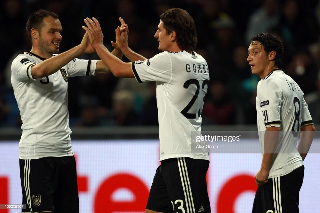 <a gi-track='captionPersonalityLinkClicked' href=/galleries/search?phrase=Mario+Gomez+-+Soccer+Player&family=editorial&specificpeople=635161 ng-click='$event.stopPropagation()'>Mario Gomez</a> (C) of Germany celebrates his team's second goal with team mates <a gi-track='captionPersonalityLinkClicked' href=/galleries/search?phrase=Heiko+Westermann&family=editorial&specificpeople=623650 ng-click='$event.stopPropagation()'>Heiko Westermann</a> (L) and <a gi-track='captionPersonalityLinkClicked' href=/galleries/search?phrase=Mesut+Oezil&family=editorial&specificpeople=764075 ng-click='$event.stopPropagation()'>Mesut Oezil</a> (R) during the EURO 2012 group A qualifier match between Kazakhstan and Germany at the Astana Arena on October 12, 2010 in Astana, Kazakhstan.