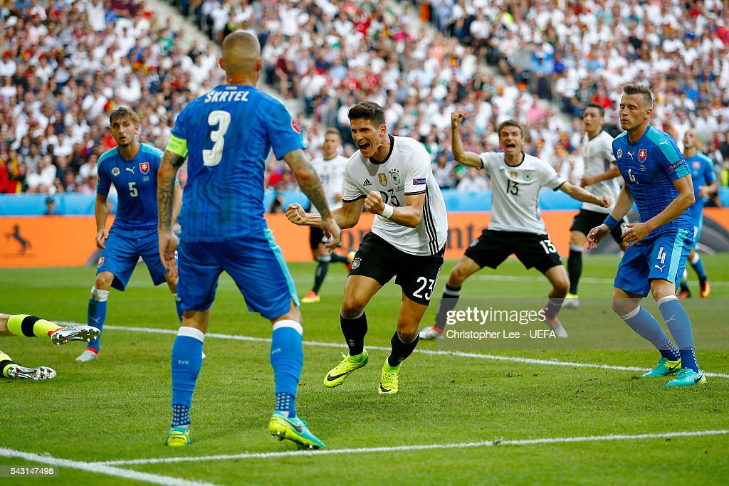 Mario Gomez (C) of Germany celebrates scoring his team's second goal during the UEFA EURO 2016 round of 16 match between Germany and Slovakia at Stade Pierre-Mauroy on June 26, 2016 in Lille, France.