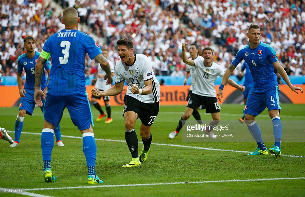 <a gi-track='captionPersonalityLinkClicked' href=/galleries/search?phrase=Mario+Gomez+-+Soccer+Player&family=editorial&specificpeople=635161 ng-click='$event.stopPropagation()'>Mario Gomez</a> (C) of Germany celebrates scoring his team's second goal during the UEFA EURO 2016 round of 16 match between Germany and Slovakia at Stade Pierre-Mauroy on June 26, 2016 in Lille, France.