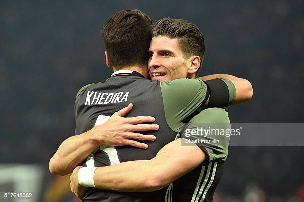 Mario Gomez of Germany celebrates scoring his team's second goal with his team mate Sami Khedira during the International Friendly match between...
