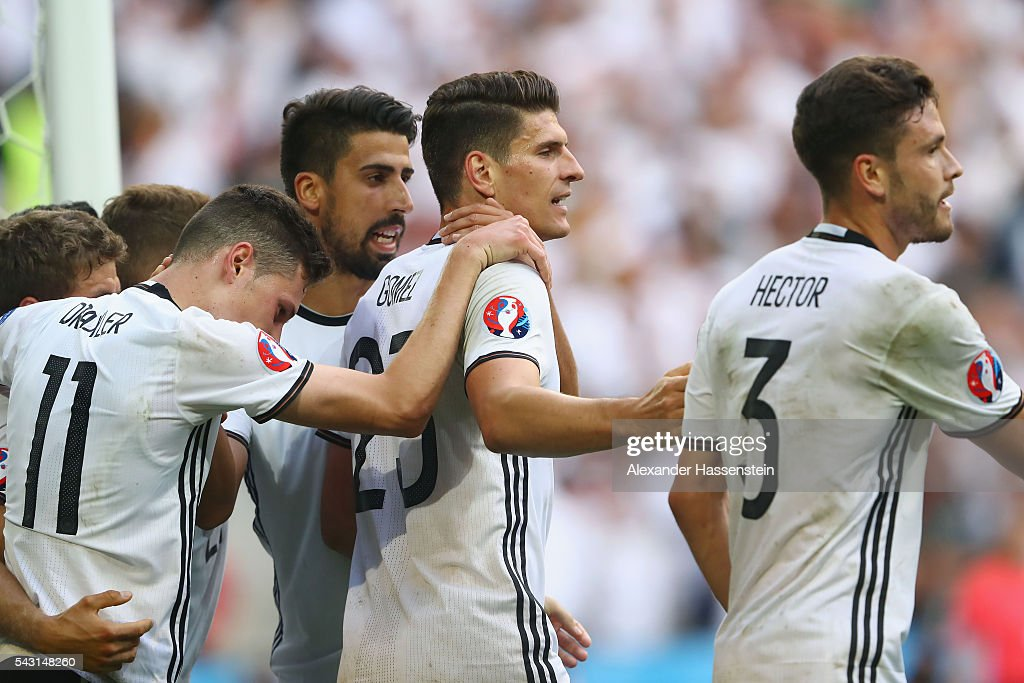<a gi-track='captionPersonalityLinkClicked' href=/galleries/search?phrase=Mario+Gomez+-+Soccer+Player&family=editorial&specificpeople=635161 ng-click='$event.stopPropagation()'>Mario Gomez</a> (2nd R) of Germany celebrates scoring his team's second goal with his team mates during the UEFA EURO 2016 round of 16 match between Germany and Slovakia at Stade Pierre-Mauroy on June 26, 2016 in Lille, France.