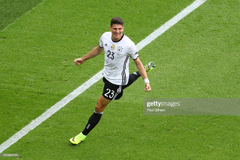 Mario Gomez of Germany celebrates scoring the opening goal during the UEFA EURO 2016 Group C match between Northern Ireland and Germany at Parc des Princes on June 21, 2016 in Paris, France.