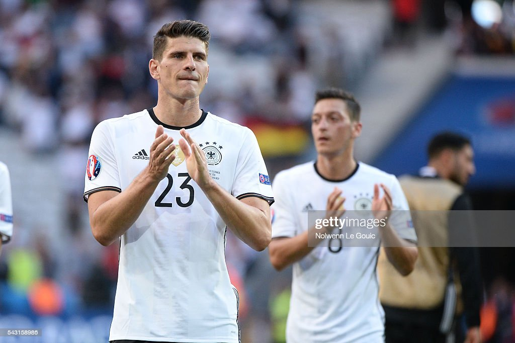 Mario Gomez of Germany celebrates victory during the European Championship match Round of 16 between Germany and Slovakia at Stade Pierre-Mauroy on June 26, 2016 in Lille, France.