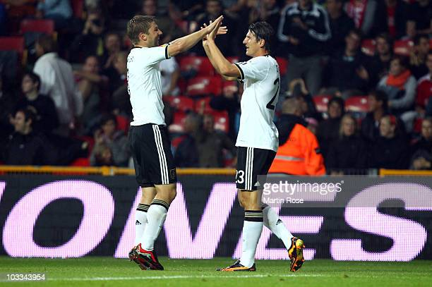Mario Gomez of Germany celebrates with his team mate Thomas Hitzlsperger after scoring the opening goal during the International Friendly match...