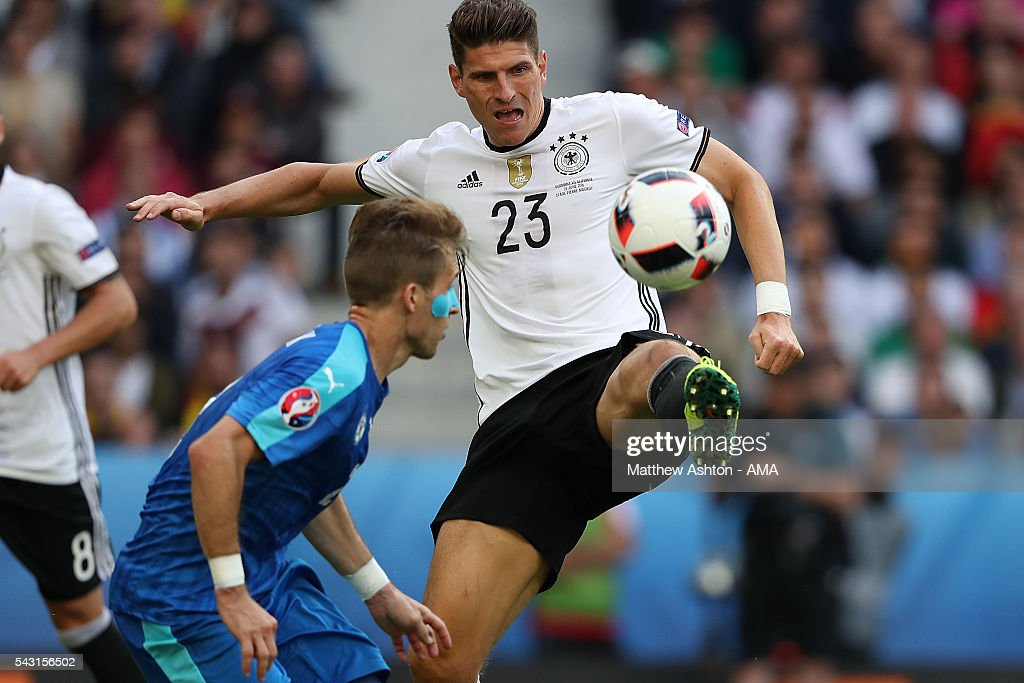 <a gi-track='captionPersonalityLinkClicked' href=/galleries/search?phrase=Mario+Gomez+-+Soccer+Player&family=editorial&specificpeople=635161 ng-click='$event.stopPropagation()'>Mario Gomez</a> of Germany in action during the UEFA Euro 2016 Round of 16 match between Germany and Slovakia at Stade Pierre-Mauroy on June 26, 2016 in Lille, France.