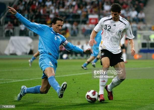 Mario Gomez of Germany is challenged by Simone Bacciocchi of San Marino during the UEFA EURO 2008 qualifier between Germany and San Marino at the...