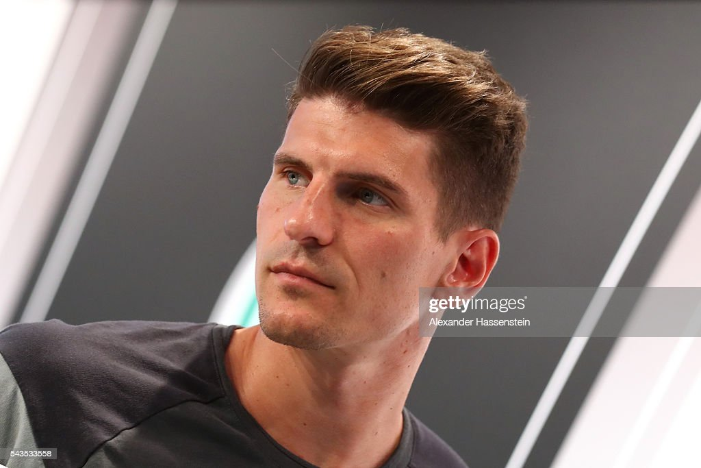 <a gi-track='captionPersonalityLinkClicked' href=/galleries/search?phrase=Mario+Gomez+-+Soccer+Player&family=editorial&specificpeople=635161 ng-click='$event.stopPropagation()'>Mario Gomez</a> of Germany looks on during a Germany press conference at Ermitage Evian on June 29, 2016 in Evian-les-Bains, France.