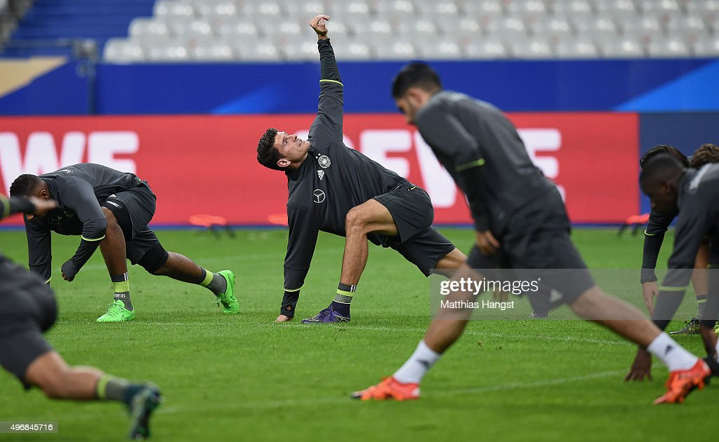 Mario Gomez (L) of Germany of Germany stretches during a Germany training session ahead of their International Friendly against France at Stade de France on November 12, 2015 in Paris, France.