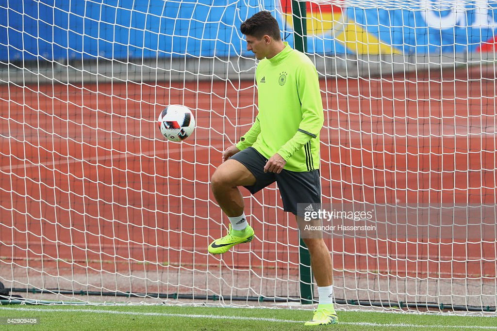 <a gi-track='captionPersonalityLinkClicked' href=/galleries/search?phrase=Mario+Gomez+-+Soccer+Player&family=editorial&specificpeople=635161 ng-click='$event.stopPropagation()'>Mario Gomez</a> of Germany plays with the ball during a Germany training session ahead of their Euro 2016 round of 16 match against Slovakia at Ermitage Evian on June 25, 2016 in Evian-les-Bains, France.