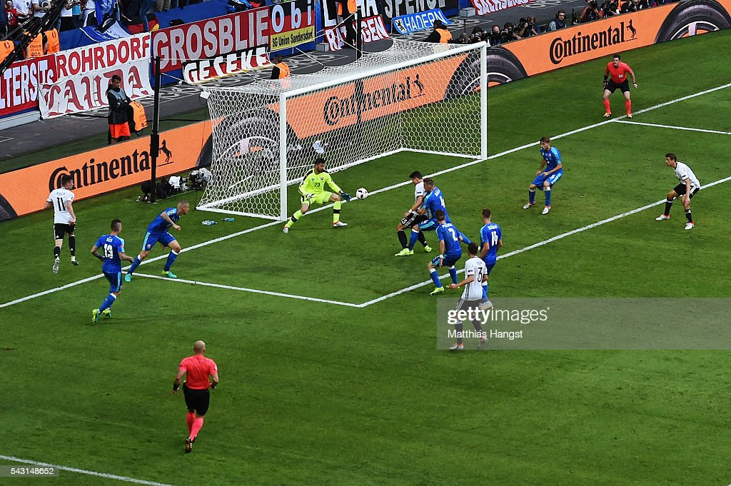 <a gi-track='captionPersonalityLinkClicked' href=/galleries/search?phrase=Mario+Gomez+-+Soccer+Player&family=editorial&specificpeople=635161 ng-click='$event.stopPropagation()'>Mario Gomez</a> of Germany scores his team's second goal past Matus Kozacik of Slovakia during the UEFA EURO 2016 round of 16 match between Germany and Slovakia at Stade Pierre-Mauroy on June 26, 2016 in Lille, France.